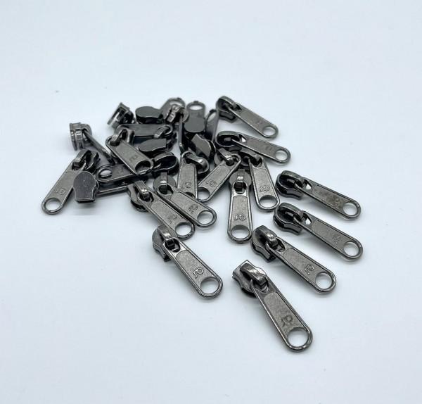 Bügelschieber für metallisierte Reißverschlussmeterware breit titan