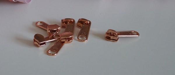 Bügelschieber für metallisierte Reißverschlussmeterware breit kupfer